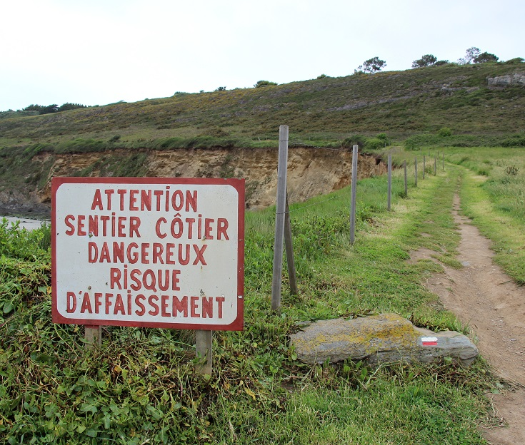 "Warning sign - ""Coastal path dangerous - risk of subsidence"""