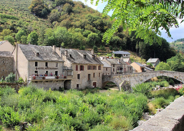 Row of stone buildings, one the Auberge des Cévennes in Le Pont-de-Montvert