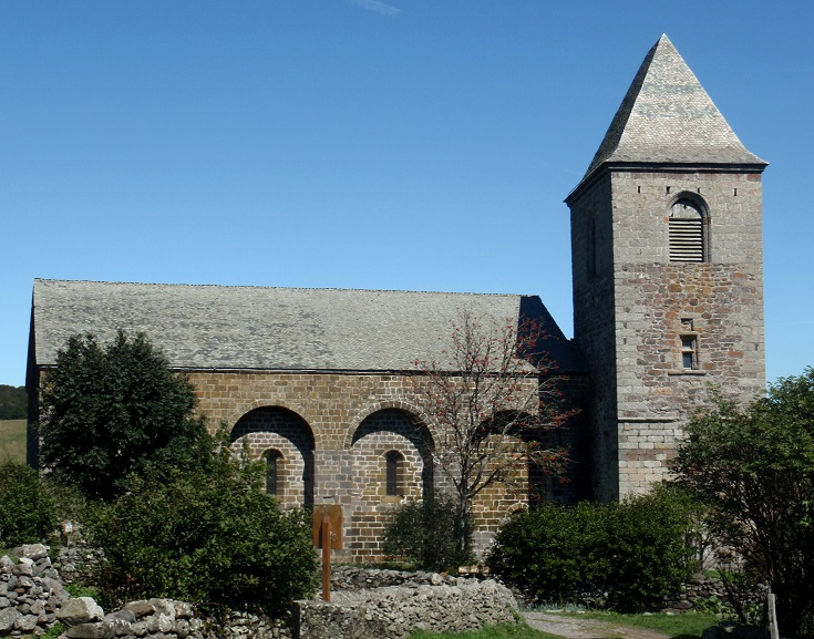Twelfth century church with brick arches and a bell tower