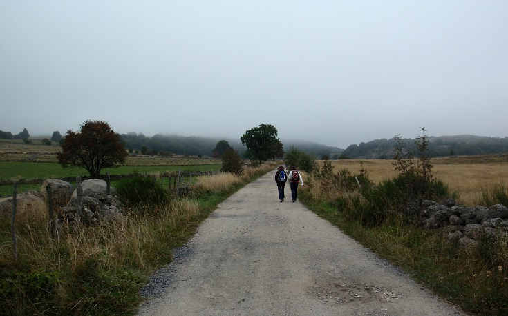 Two walkers on the path between Nasbinals and Aubrac