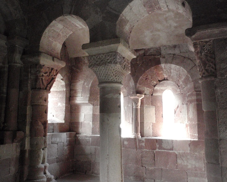 Columns of red sandstone inside the twelfth-century chapel of Saint-Michel