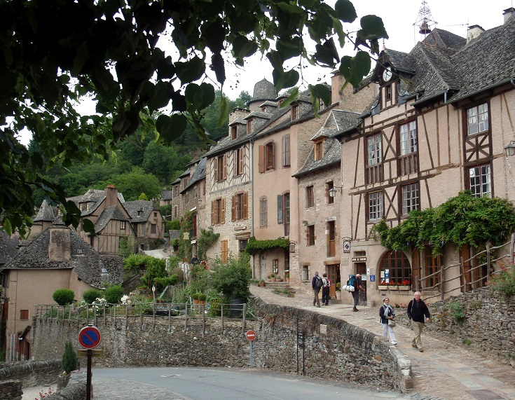 Stone and timber buildings, including the Tourist Office, Conques