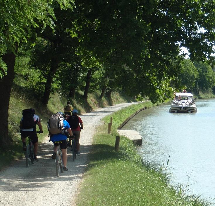 Cyclists approach Sauzens, Midi Canal