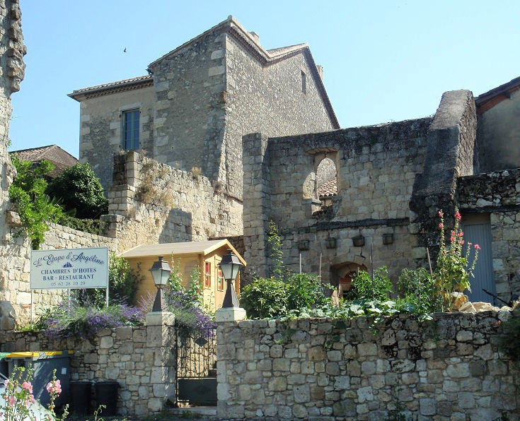 Stone walls and buildings in the streets of La Romieu ooze medieval charm