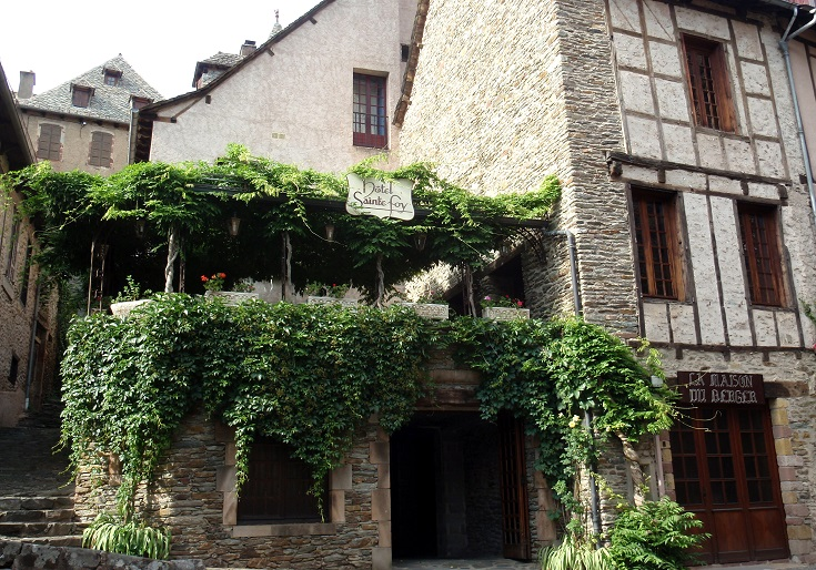Wisteria covers the terrace of the restaurant of Hotel Sainte Foy