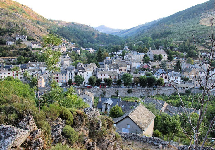 Viewed from the ridge above the village, the stone buildings of Le Pont-de-Montvert sprawl along the river