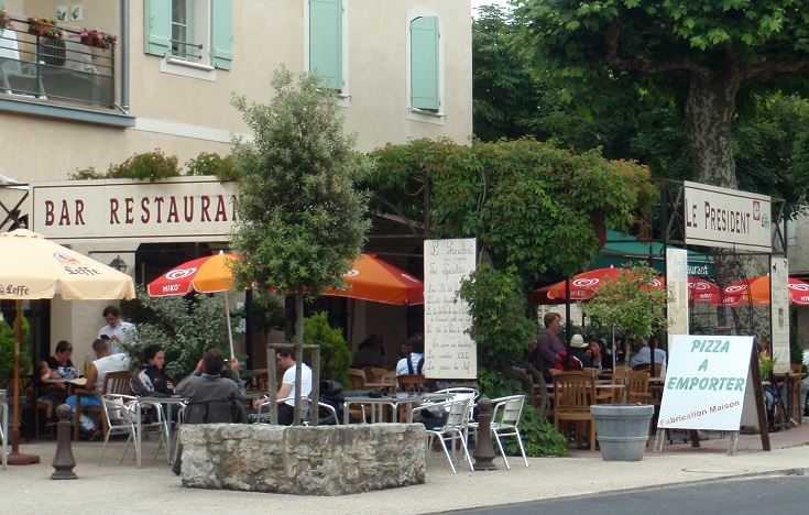 Diners in outdoor seating at Café le President, Cajarc