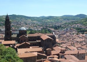 View over the cathedral and house rooftops to the green hills where the Chemin de Saint-Jacques and Chemin de Stevenson begin
