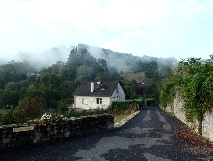 A thin layer of mist hangs of the valley of Espeyrac