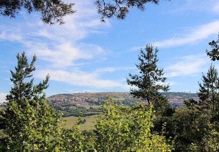 Glimpses of Le Monastier-sur-Gazeille on a distant hill