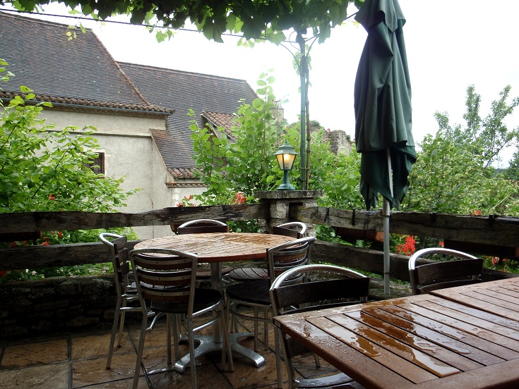 The terrace of Café Lou Bolat, soaked from a sudden rain shower