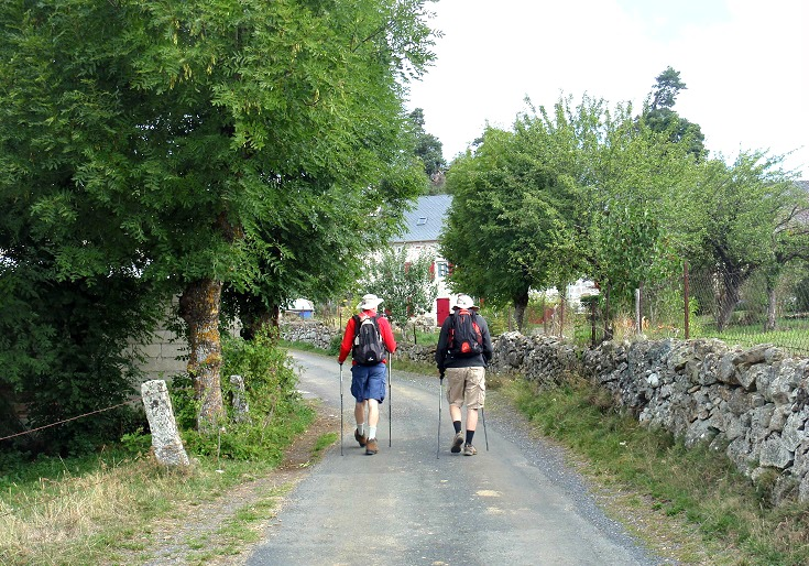Long distance walkers approach la-Chaze-de-Peyre, GR 65