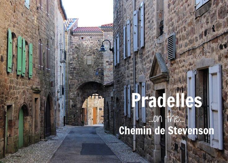 Narrow lane leading to stone arch, Portail du Besset, in Pradelles France