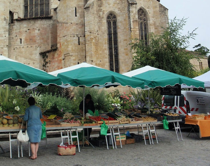 Fruit and vegetable stall set up in front of the cathedral in Condom, France