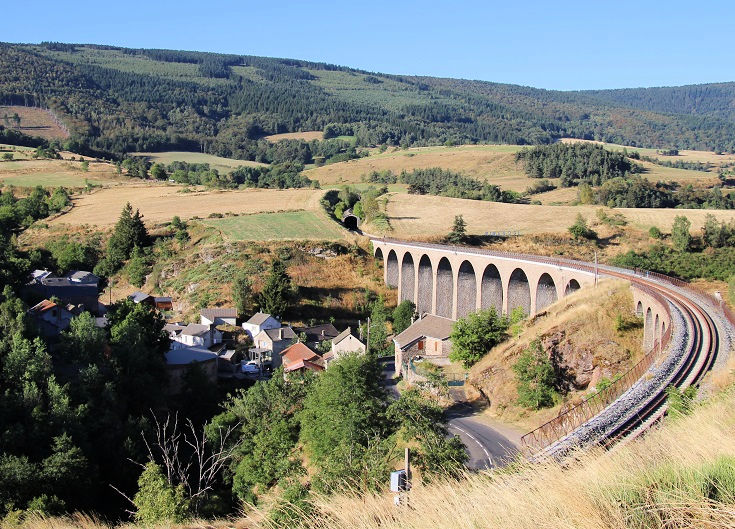 A railway viaduct curls high above the village of Mirandol