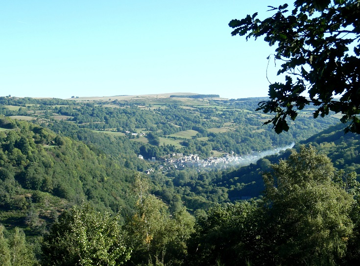 View of Saint-Chély-d'Aubrac from the top of the ridge, the village nestles into the bottom of the valley