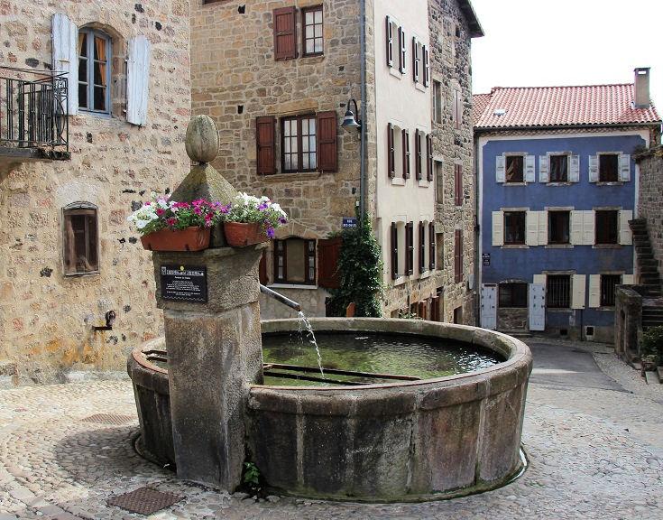 Stone water fountain near Place de la Halle, Pradelles, Chemin de Stevenson